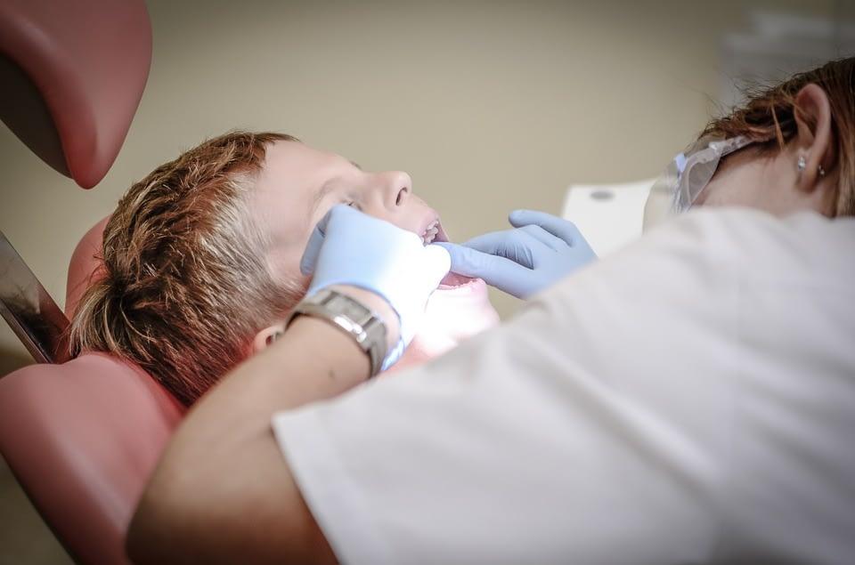 boy in a dentist room