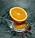 sliced orange drop in water