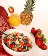 cereal with strawberry and pineapple fruit in bowl