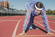 woman getting ready to run on a track field