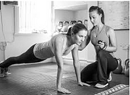 Trainer and trainee in workout