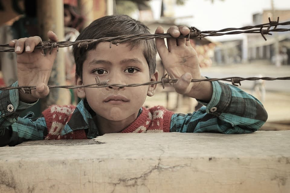 boy holding bulbwire